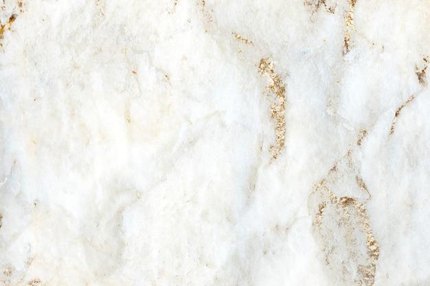 Fond texturé en marbre blanc doré