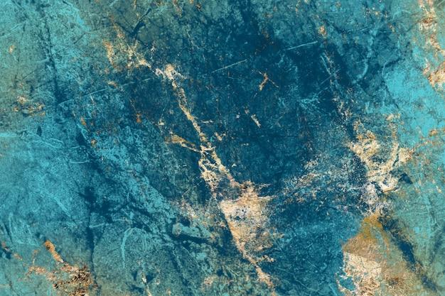 Fond texturé en marbre bleu et or