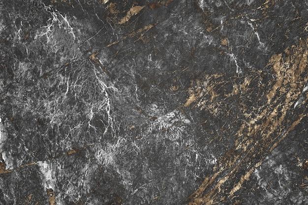 Fond texturé en marbre gris et or