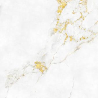 Fond de texture en marbre avec des reflets dorés