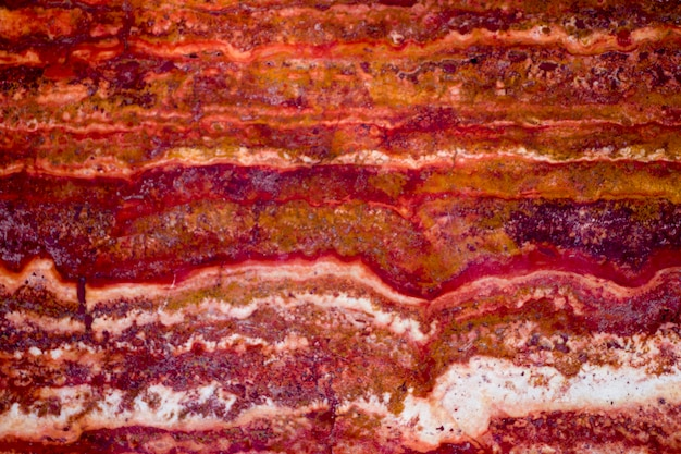 Fond de texture de marbre rouge, marbre de brèche naturel pour les carreaux de mur et de sol en céramique, marbre rouge poli, texture de pierre de marbre naturel véritable et fond de surface.