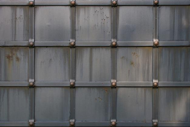 Fond de texture en métal gris grunge avec rivets