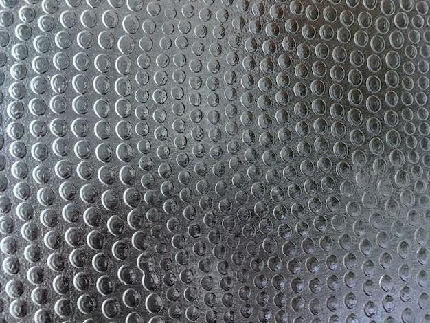 Fond de texture en métal perforé gris foncé