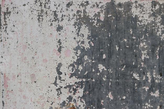 Fond avec texture en métal rouillé dans les couleurs grises et blanches