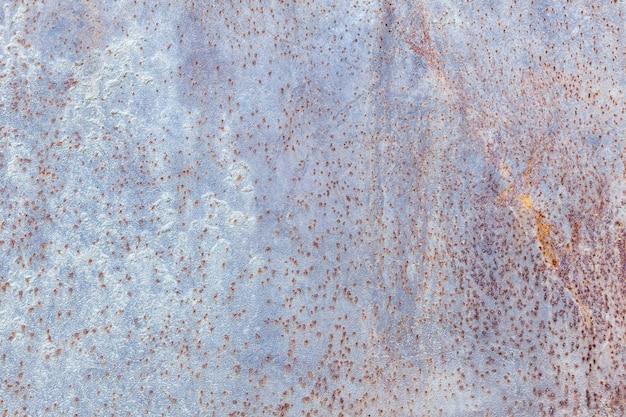 Fond de texture en métal rouillé foncé usé, effet vintage,