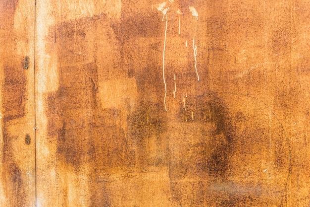 Fond de texture en métal rouillé usé orange