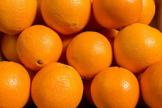 Fond de texture de motif coloré de fruits abstraits orange frais