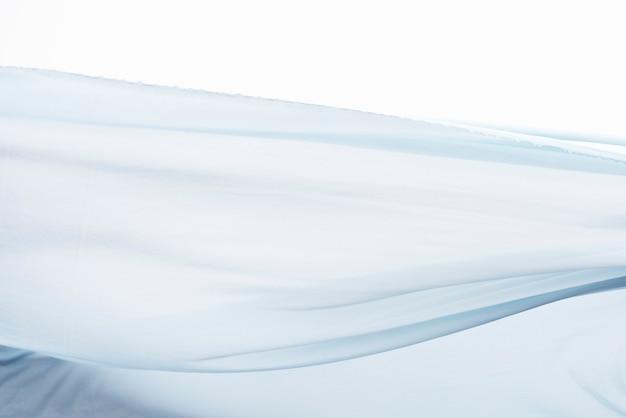 Fond de texture de mouvement de tissu bleu