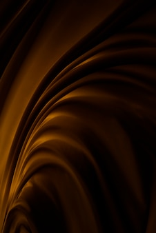 Fond de texture de mouvement de tissu marron foncé