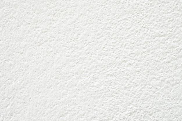 Fond texturé de mur de béton blanc pour la conception intérieure et extérieure décorative