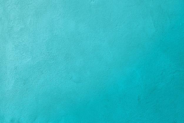 Fond de texture de mur en béton de couleur turquoise avec une surface en béton finement rugueuse. ce n'est pas du bruit ou du grain de film.