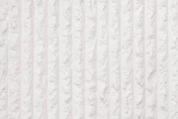 Fond texturé de mur de béton rayé beige pastel