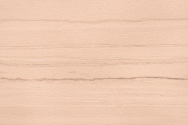 Fond texturé de mur de béton rose