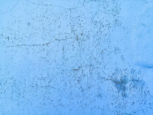 Fond de texture de mur bleu avec des fissures