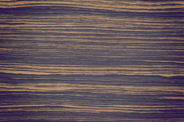 Fond ou texture de mur en bois aux tons