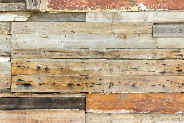 Fond et texture de mur en bois coloré