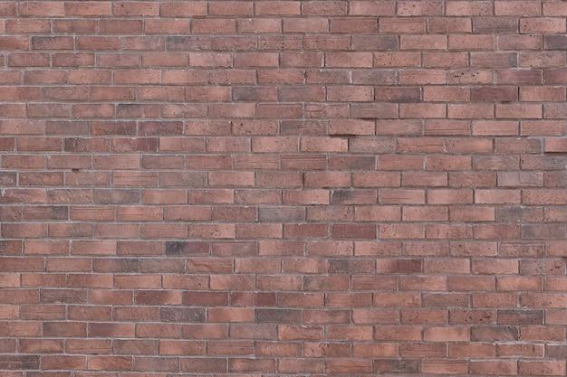 Fond de texture de mur de brique ancienne rouge avec coins vignettés pour la décoration intérieure