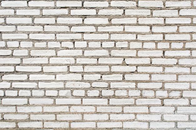 Fond de texture de mur de brique blanche