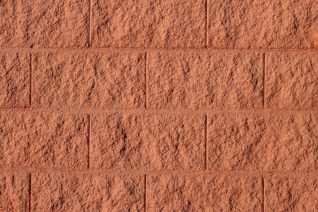 Fond de texture de mur de brique brune