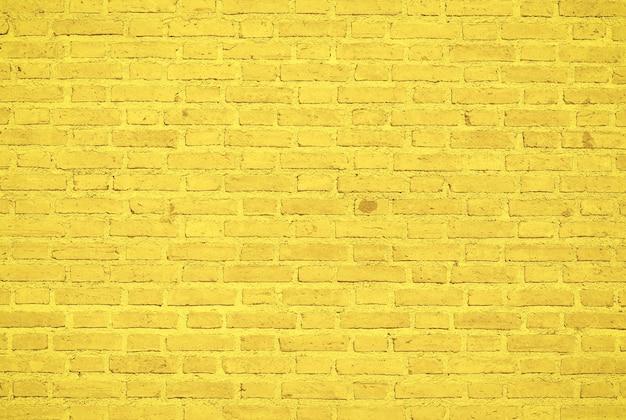 Fond de texture de mur de brique jaune