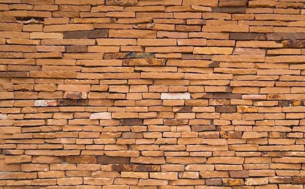 Fond de texture de mur de brique orange avec un espace pour le texte