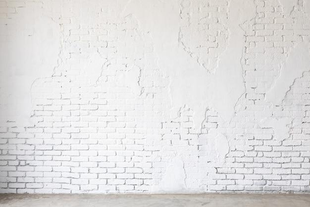 Fond de texture de mur de briques blanches grunge. arrière-plan pour la conception de bannières maquette.