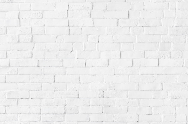 Fond texturé mur de briques blanches