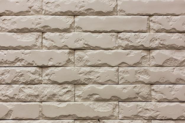 Fond de texture de mur de briques de pierre cassée blanche