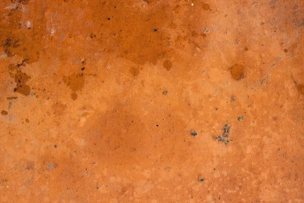 Fond de texture de mur de ciment orange-brun