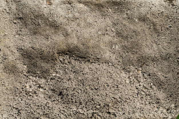 Fond de texture de mur gris vallonné en béton