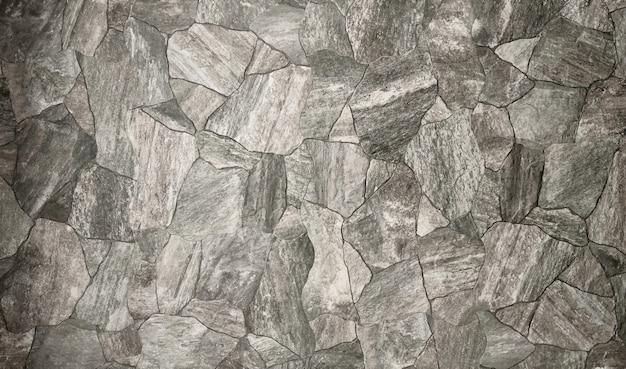 Le fond de texture de mur en pierre blanche.