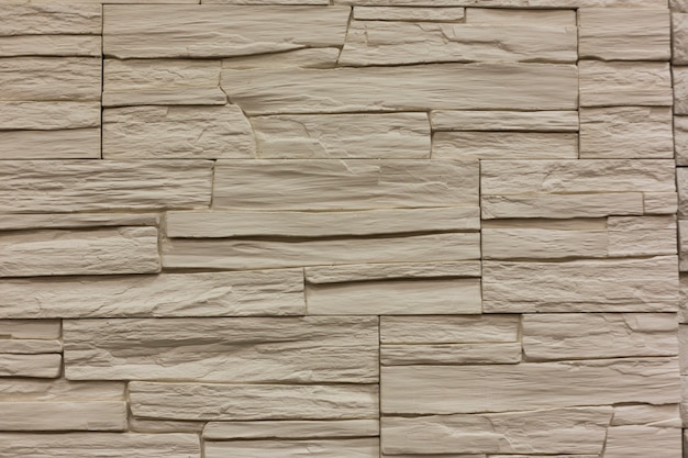 Fond de texture de mur en pierre blanche