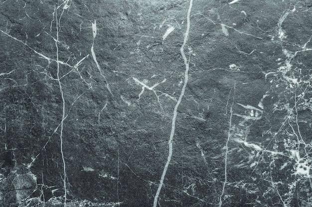 Fond de texture de mur en pierre de marbre noir naturel
