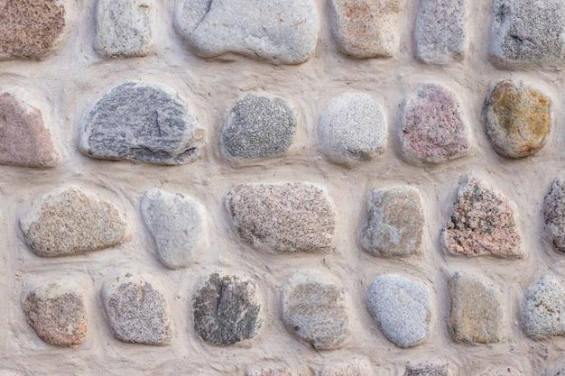 Fond de texture de mur en pierre mur ancien construit en pierre blanche. pierres naturelles. mur texturé
