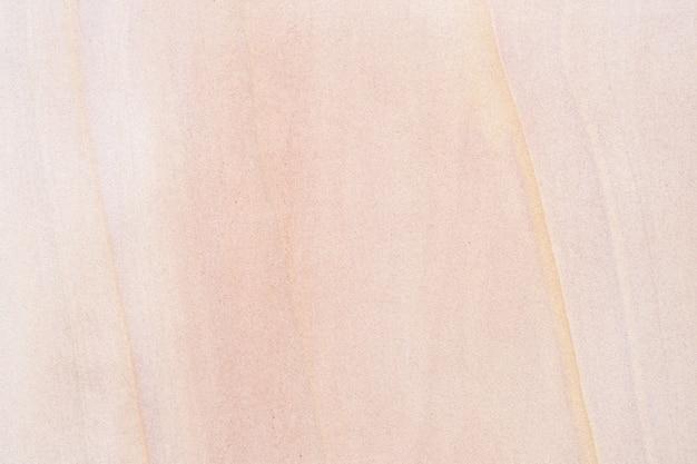 Fond de texture de mur en pierre rouge sable. sol