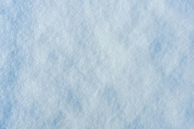Fond de texture de neige fraîche dans le ton bleu