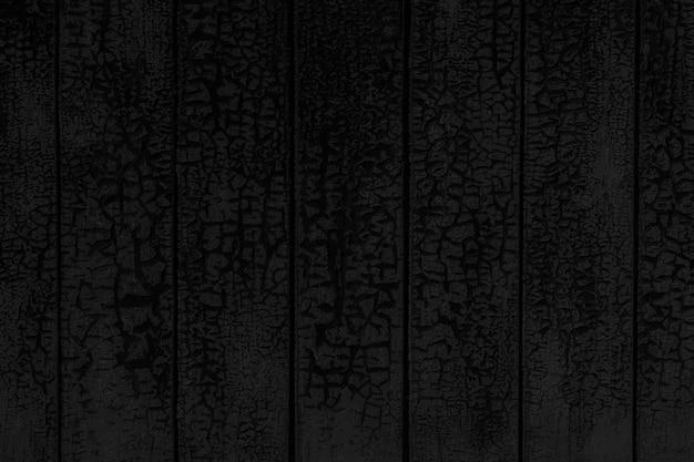 Fond texturé noir de mur en bois peint fissuré