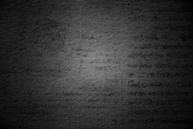 Fond texturé de page imprimée noire grunge
