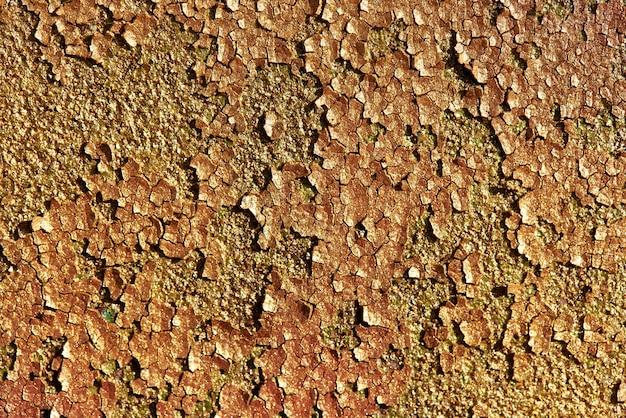 Fond de texture de paillettes brillantes d'or. texture de fond de vieux métal rouillé avec de la peinture fissurée.