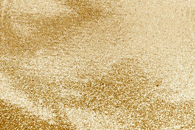 Fond texturé de paillettes d'or