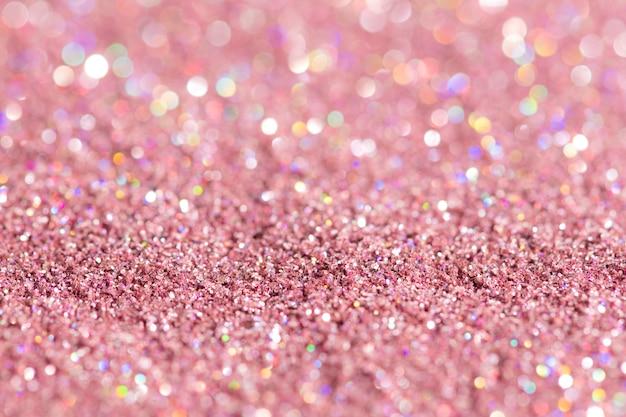 Fond texturé de paillettes rose brillant