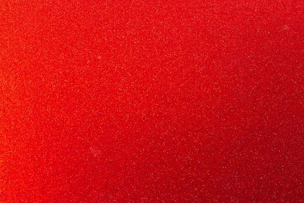 Fond de texture de paillettes rouges, décoration rougeoyante et photo de concept de surface de noël