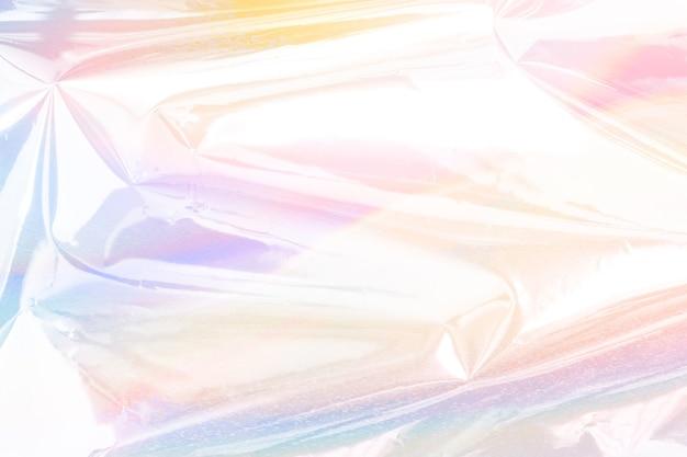 Fond texturé de papier d'aluminium froissé holographique coloré