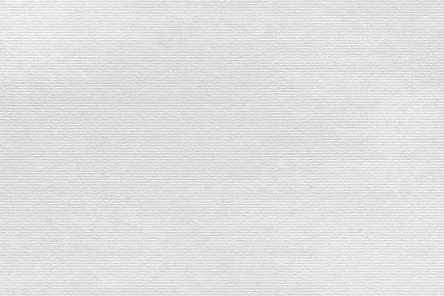 Fond de texture de papier blanc. motif de bandes parallèles côtelées. peut être utilisé pour la présentation, la texture du papier et les modèles web avec un espace pour le texte.