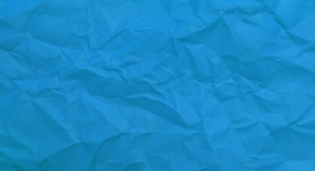 Fond de texture de papier bleu aggloméré, papier kraft horizontal avec un design unique de papier, style de papier naturel pour un design créatif esthétique