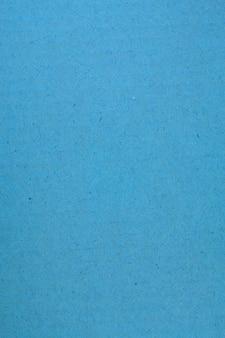 Fond de texture papier bleu rayé.