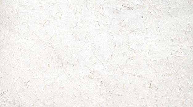 Fond de texture de papier fabriqué à partir de feuilles naturelles. concept de bannière de fond de texture de papier recyclé.
