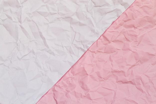 Fond de texture de papier froissé froissé rose et blanc