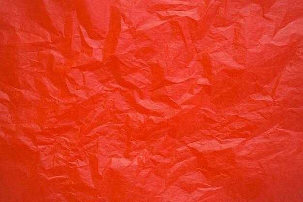 Fond de texture de papier froissé rouge