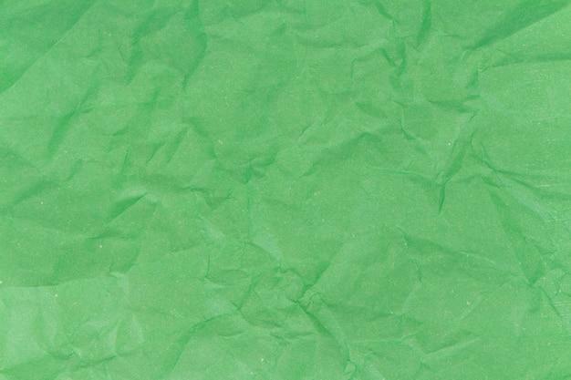 Fond de texture de papier froissé vert